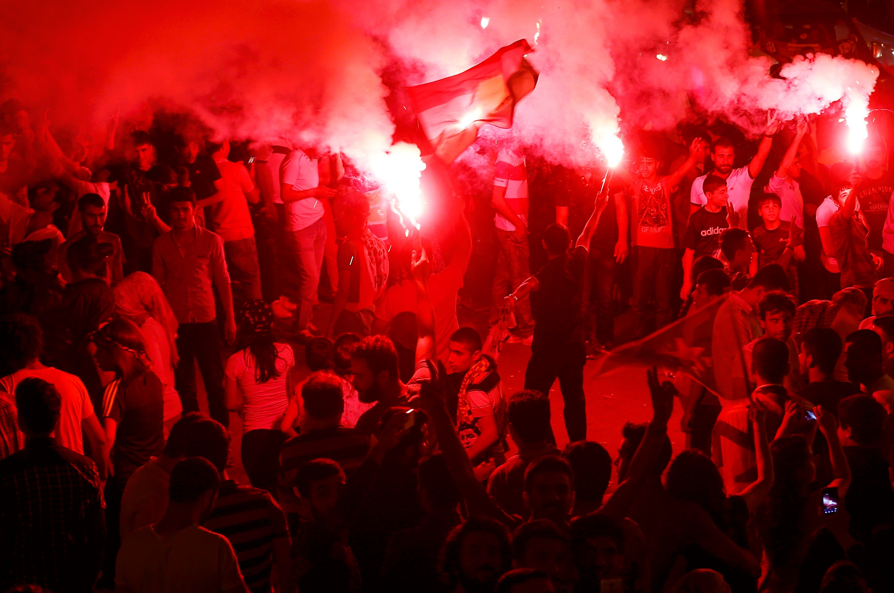 Supporters light flares as they celebrate early election results outside the pro-Kurdish Peoples' Democratic Party (HDP) headquarters in Diyarbakir, Turkey, June 7, 2015. (Reuters)
