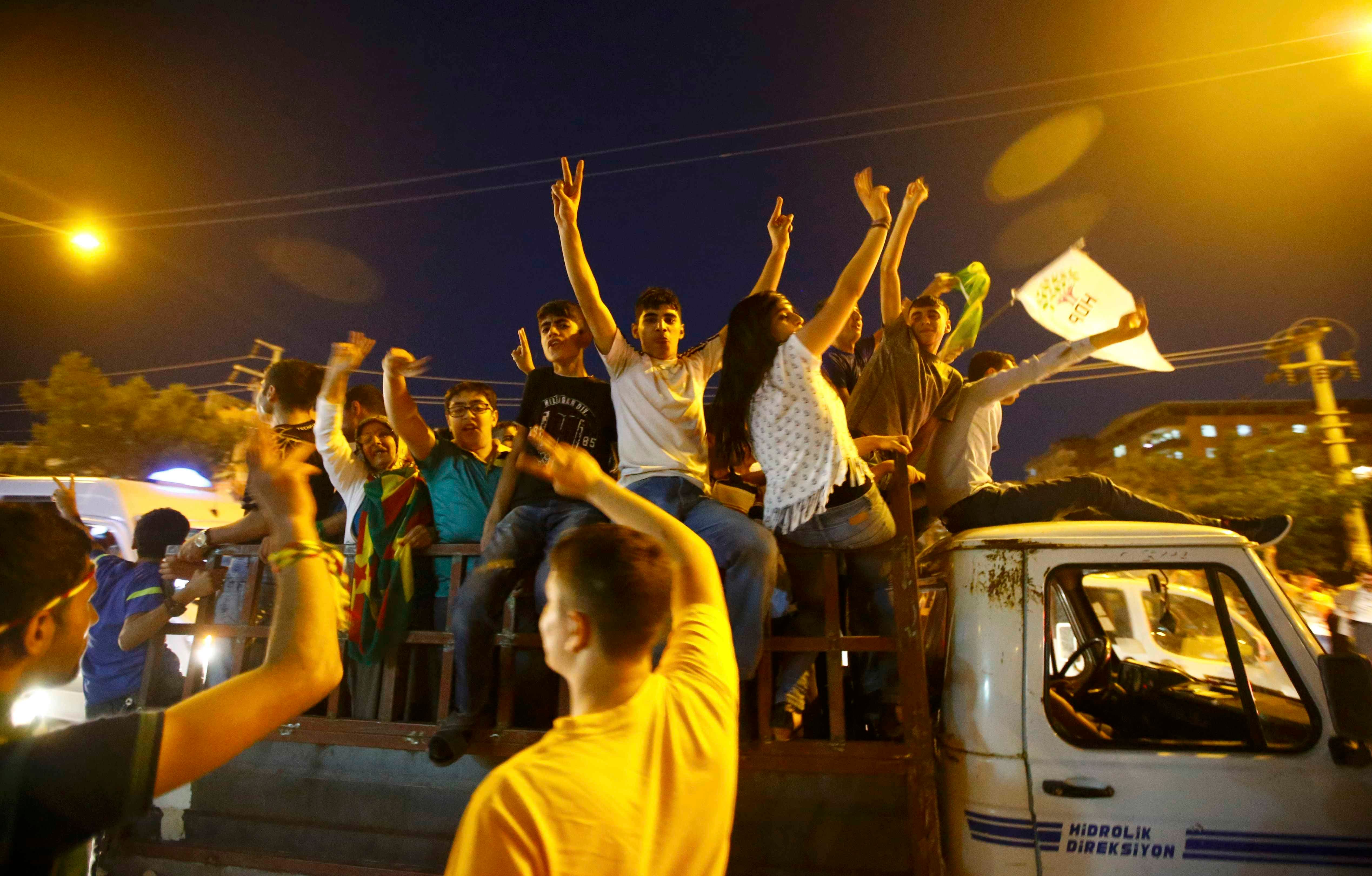 Supporters of the pro-Kurdish Peoples' Democratic Party (HDP) ride on a truck as they celebrate along a street after the parliamentary election in Diyarbakir, Turkey, June 7, 2015. (Reuters)