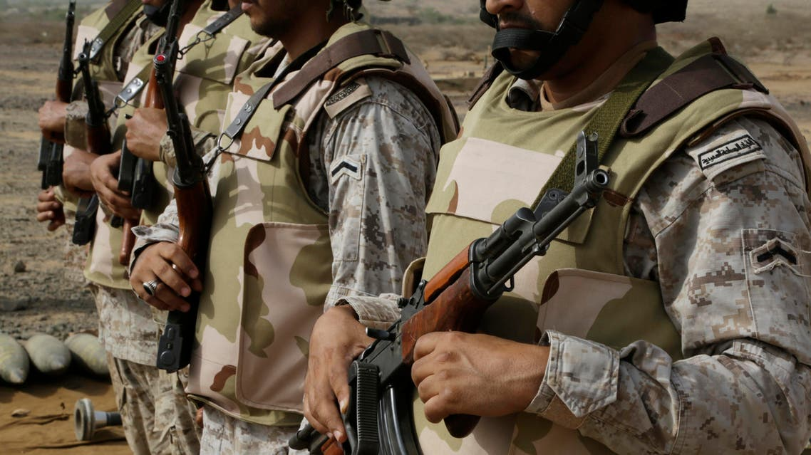 In this photo taken on April 20, 2015, Saudi soldiers with their weapons stand guard at the Yemen border in Jizan, Saudi Arabia. (AP)