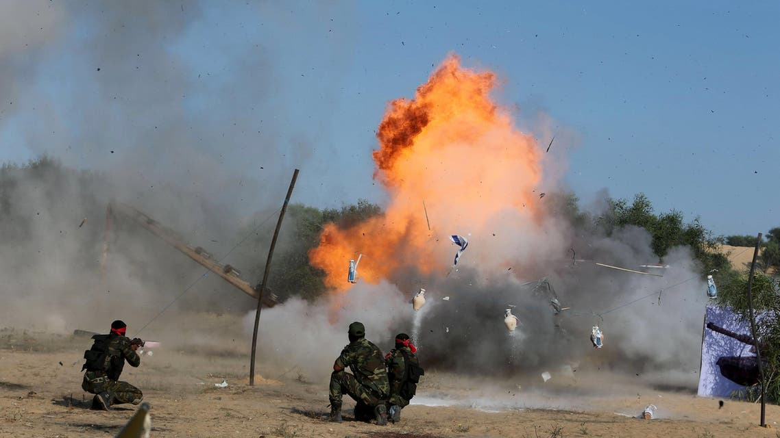 Palestinians from the Democratic Front for the Liberation of Palestine (DFLP) demonstrate their skills at a scene simulating an attack on an Israeli site during a military graduation ceremony in Rafah in the southern Gaza Strip. (AP)