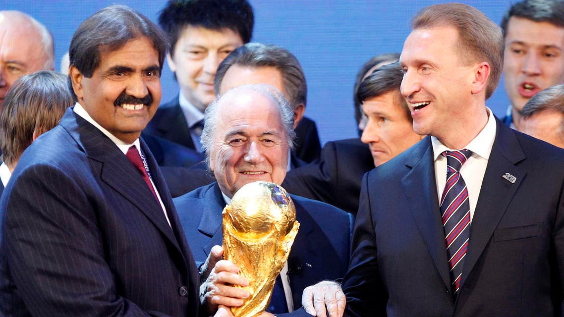 FIFA President Joseph Blatter is flanked by Russian Deputy Prime Minister Igor Shuvalov, right, and Sheikh Hamad bin Khalifa Al-Thani, Emir of Qatar, after the announcement that Russia will be the host country for the soccer World Cup 2018 and Qatar the host for the tournament in 2022 in Zurich, Switzerland, Thursday, Dec.2, 2010. (File Photo: AP)