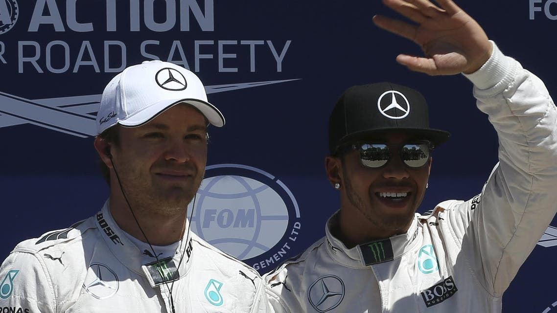 Mercedes F1 driver Lewis Hamilton of Britain poses with team mate Nico Rosberg of Germany after qualifying for pole position ahead of the Canadian F1 Grand Prix in Montreal. (Reuters)