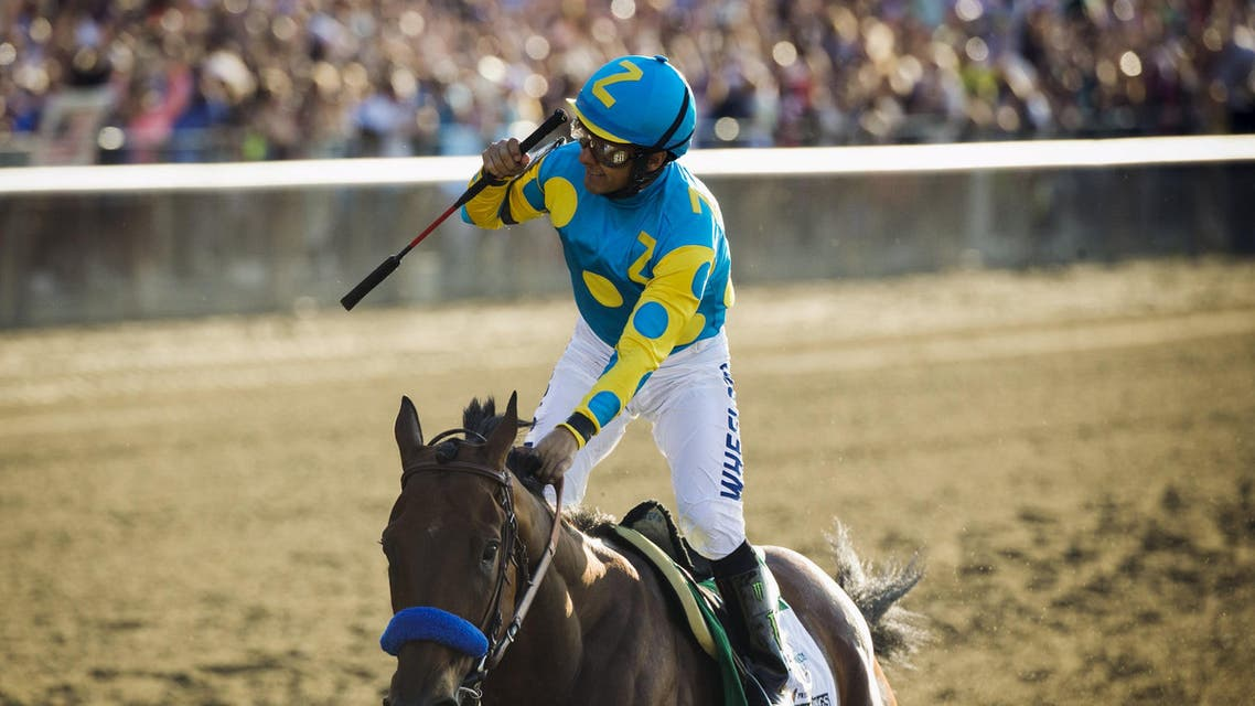 Espinoza, aboard American Pharoah, celebrates after winning the 147th running of the Belmont Stakes as well as the Triple Crown, in Elmont, New York. (Reuters)