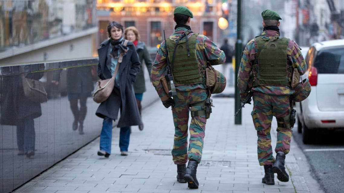 Two Belgian soldiers patrol the street outside of EU headquarters during a meeting of EU foreign ministers in Brussels on Monday, Jan. 19, 2015. The European Union is calling for an anti-terror alliance with Arab countries to boost cooperation and information sharing in the wake of deadly attacks and arrests across Europe linked to foreign fighters. (AP Photo/Virginia Mayo)
