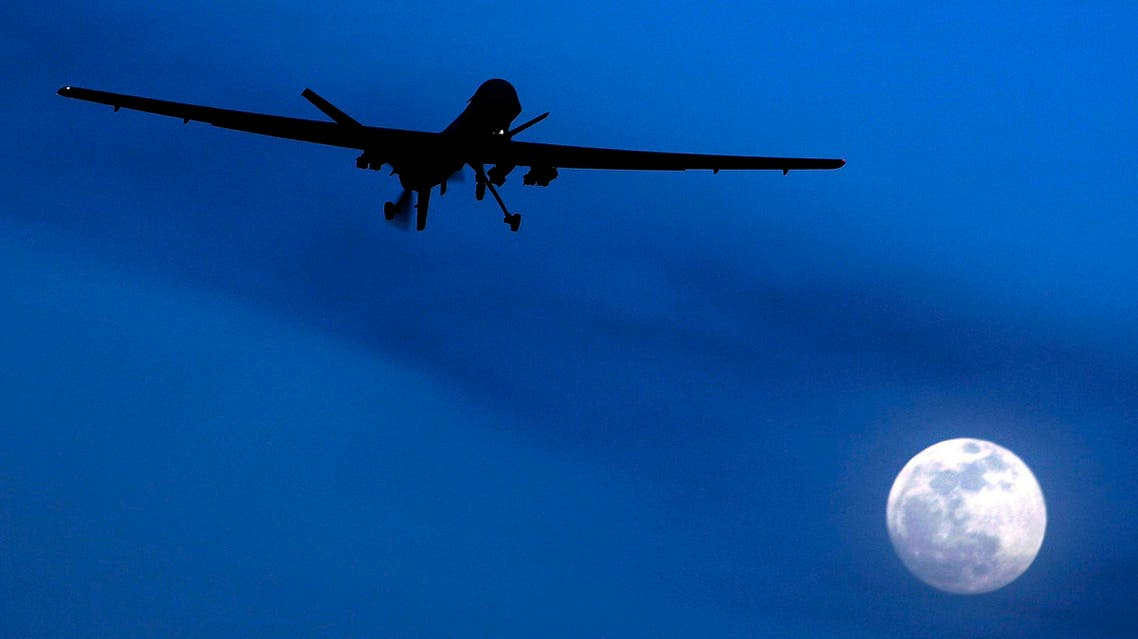 FILE - In this Jan. 31, 2010 file photo, an unmanned U.S. Predator drone flies over Kandahar Air Field, southern Afghanistan, on a moon-lit night. A U.N. expert on Friday, Oct. 18, 2013 called on the United States to reveal the number of civilians it believes have been killed by American drone strikes targeting Islamic militants. U.N. Special Rapporteur Ben Emmerson said that preliminary information gathered for a new report indicated more than 450 civilians may have been killed by drone strikes in Pakistan, Afghanistan and Yemen, but more work needs to be done to confirm the figures.(AP Photo/Kirsty Wigglesworth, File)