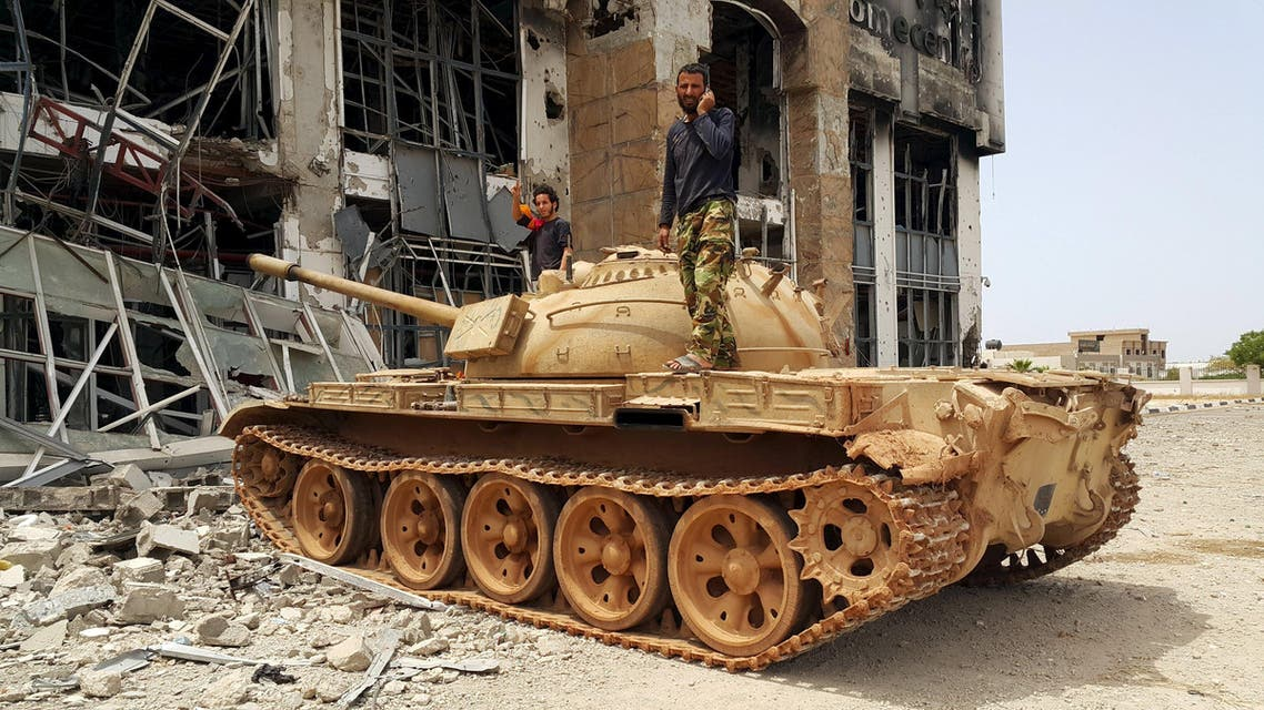 Members of the Libyan pro-government forces stand on a tank in Benghazi. (Reuters)
