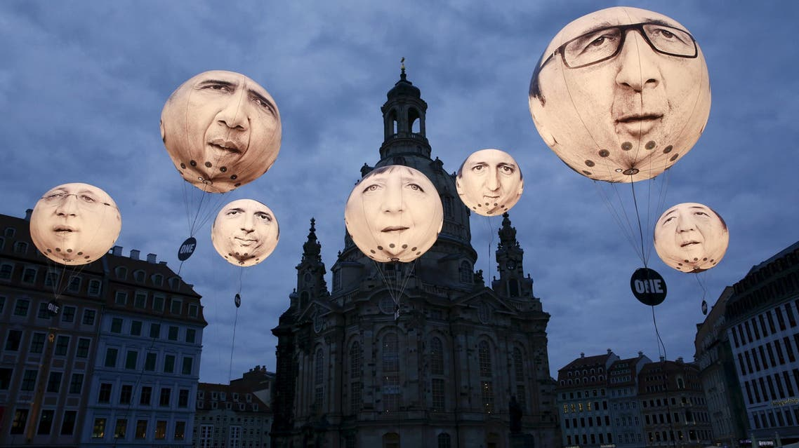 Balloons made by the 'ONE' campaigning organisation depicting leaders of the countries members of the G7 in Dresden. (Reuters)