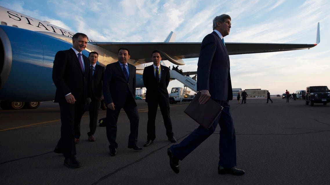 U.S. Secretary of State John Kerry, right, walks to his motorcade after being greeted by U.S. Ambassador to Egypt Stephen Beecroft, left, in Sharm el-Sheikh, Egypt Friday, March 13, 2015. (AP)