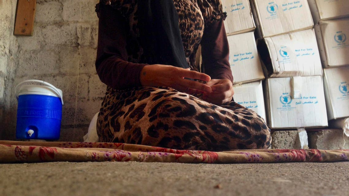 this file photo taken Wednesday, Oct. 8, 2014, a 15-year-old Yazidi girl captured by the Islamic State group and forcibly married to a militant in Syria sits on the floor of a one-room house she now shares with her family after escaping in early August. (AP)