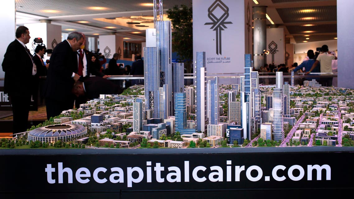 FILE - In this Saturday, March 14, 2015 file photo, a model of a planned new capital for Egypt is on display at an economic conference in Sharm el-Sheikh, Egypt. It's a monumental, ambitious project: An eco-friendly city the size of Singapore in the desert outside Cairo to serve as a new capital, with skyscrapers and a park more than twice the size of New York's Central Park. But urban planners and real estate experts say the plans remain a mystery and are skeptical it can or should be done. (AP Photo/Hassan Ammar, File)