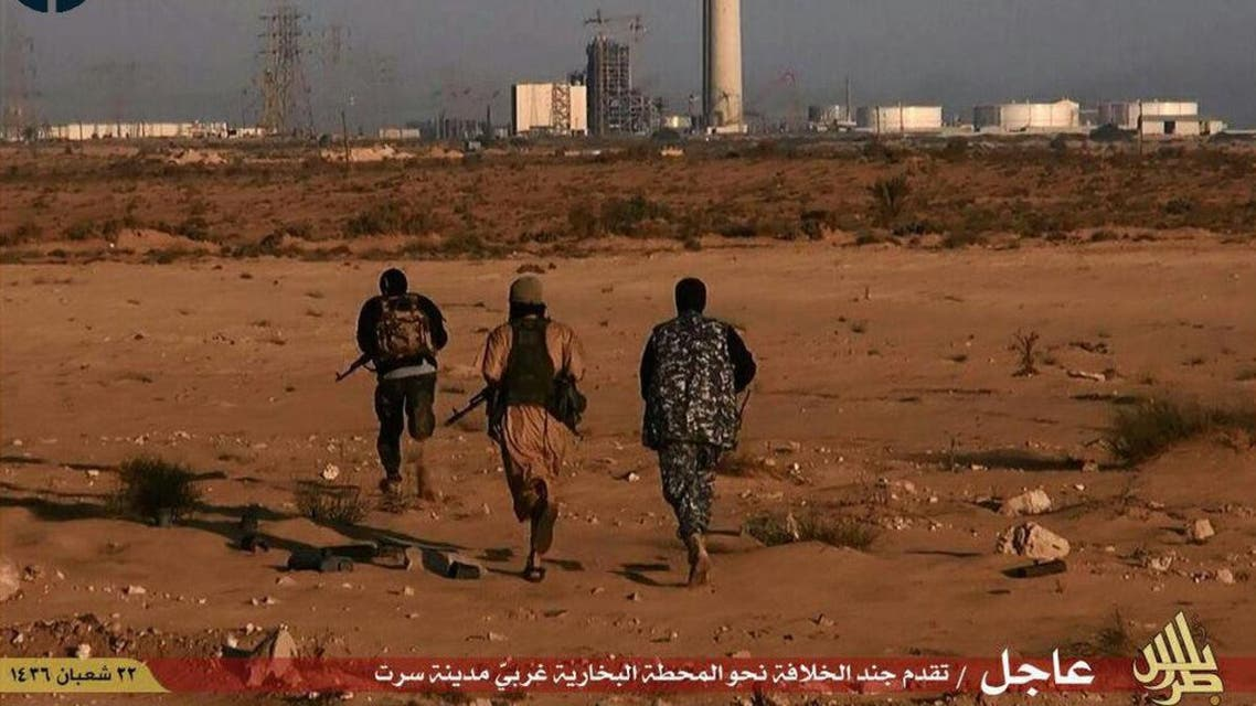 An image taken from jihadist media outlet Wilayat Trablus and provided courtesy of the US-based monitoring agency SITE Intelligence Group on June 9, 2015 allegedly shows Islamic State (IS) group fighters running towards what they say is a power plant in the southern Libyan city of Sirte after IS claimed to have seized full control of the city from Fajr Libya militia. AFP