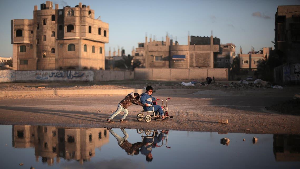 Palestinian children play on the street in Deir el-Balah refugee camp, central Gaza Strip, Saturday, Feb. 21, 2015. (AP)
