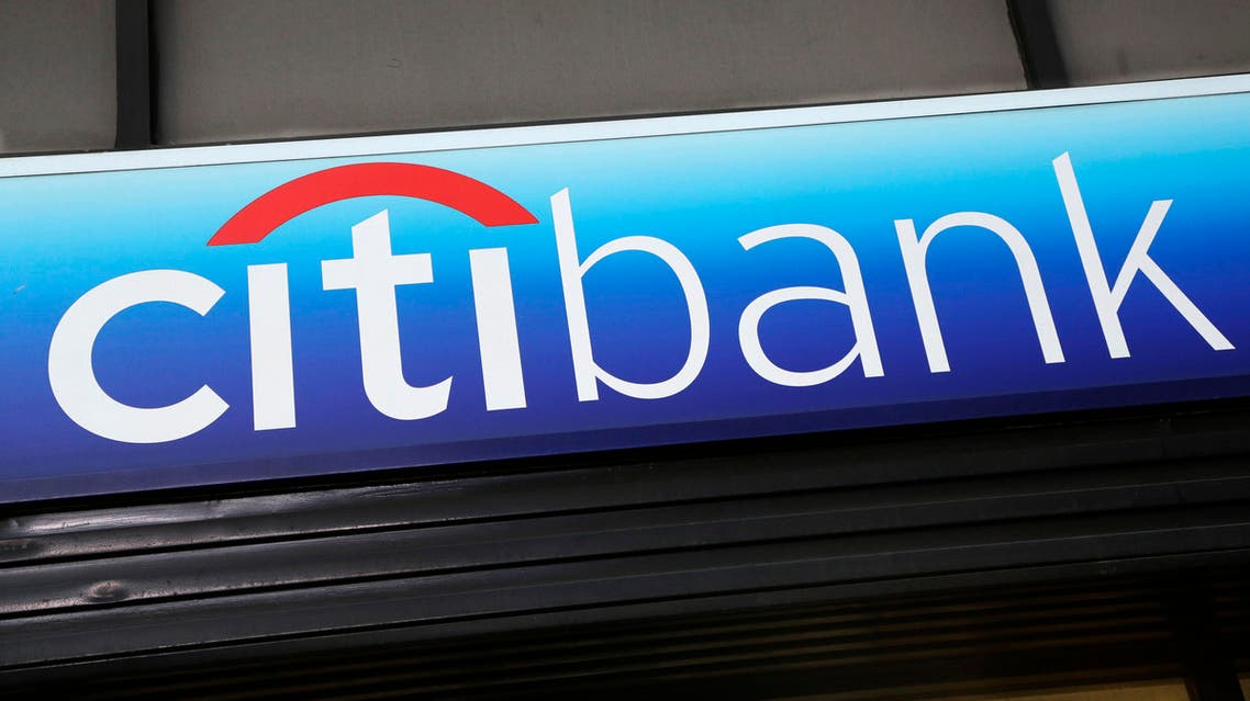 A Citibank sign hangs above a branch office, Thursday, Jan. 15, 2015, in New York. Citigroup said its fourth-quarter profit dropped 86 percent after incurring large legal and restructuring charges. (AP Photo/Mark Lennihan)