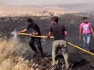 بالفيديو .. قوات الأسد تحرق محاصيل زراعية في الحولة