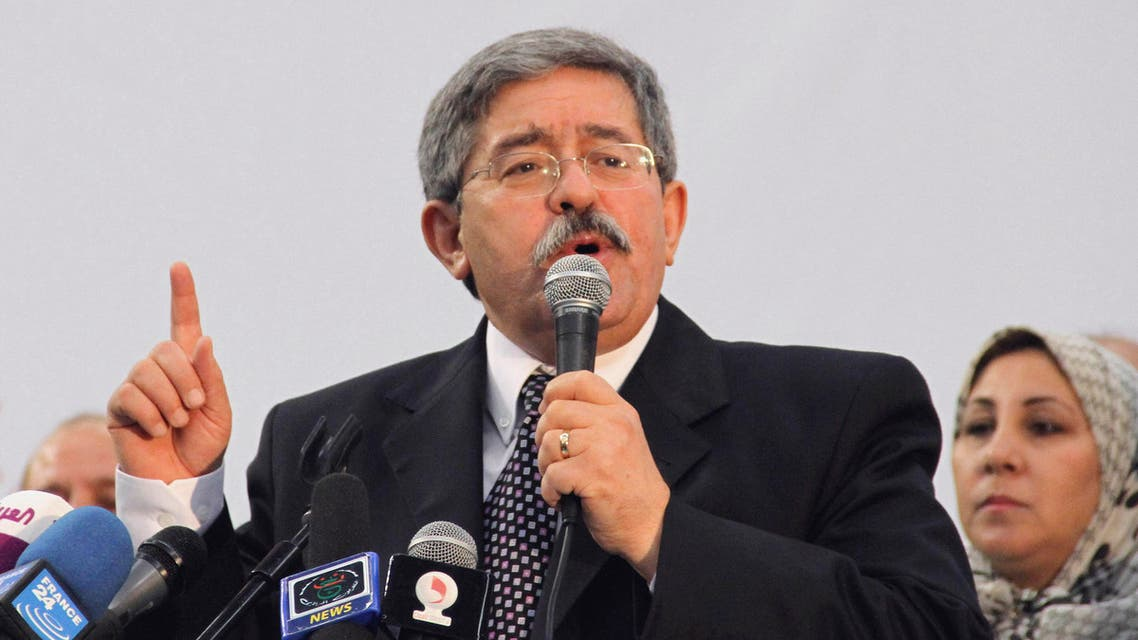 In this Saturday May 5, 2012 file photo, Algerian Prime Minister Ahmed Ouyahia promises continuity if his party, the National Democratic Rally, is re-elected, at the final party rally in the capital Algiers.  (AP)