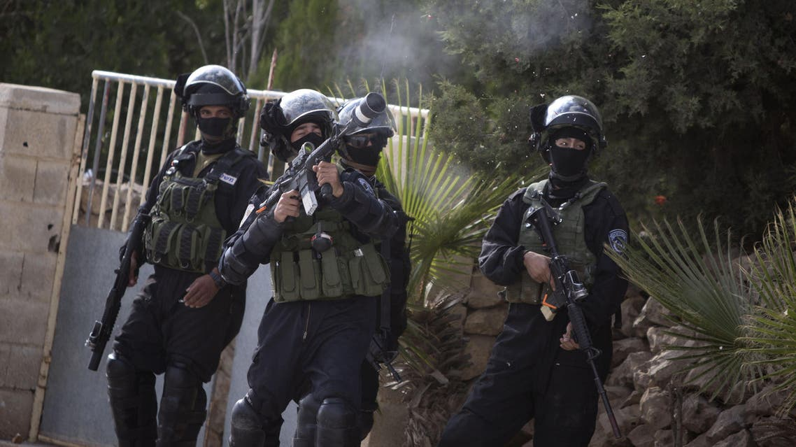 Israeli border policeman fire teargas at Palestinian protesters during an occasional protest against the nearby Jewish settlement Ofra in the village of Silwad near the West Bank city of Ramallah on Friday, June 5, 2015. (AP)