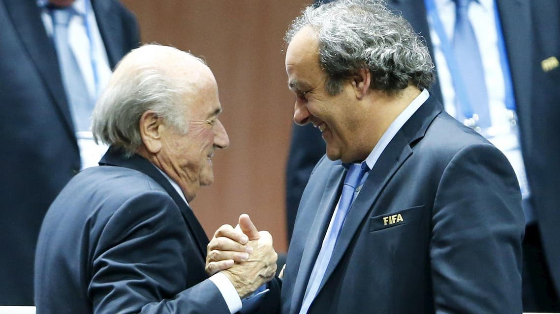 UEFA President Michel Platini (R) congratulates FIFA President Sepp Blatter after he was re-elected at the 65th FIFA Congress in Zurich, Switzerland, in this May 29, 2015. (File Photo: Reuters)