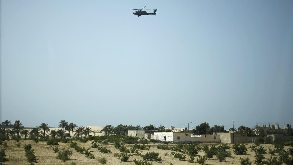 A military helicopter conducts an aerial patrol above Sheikh Zuwayed city