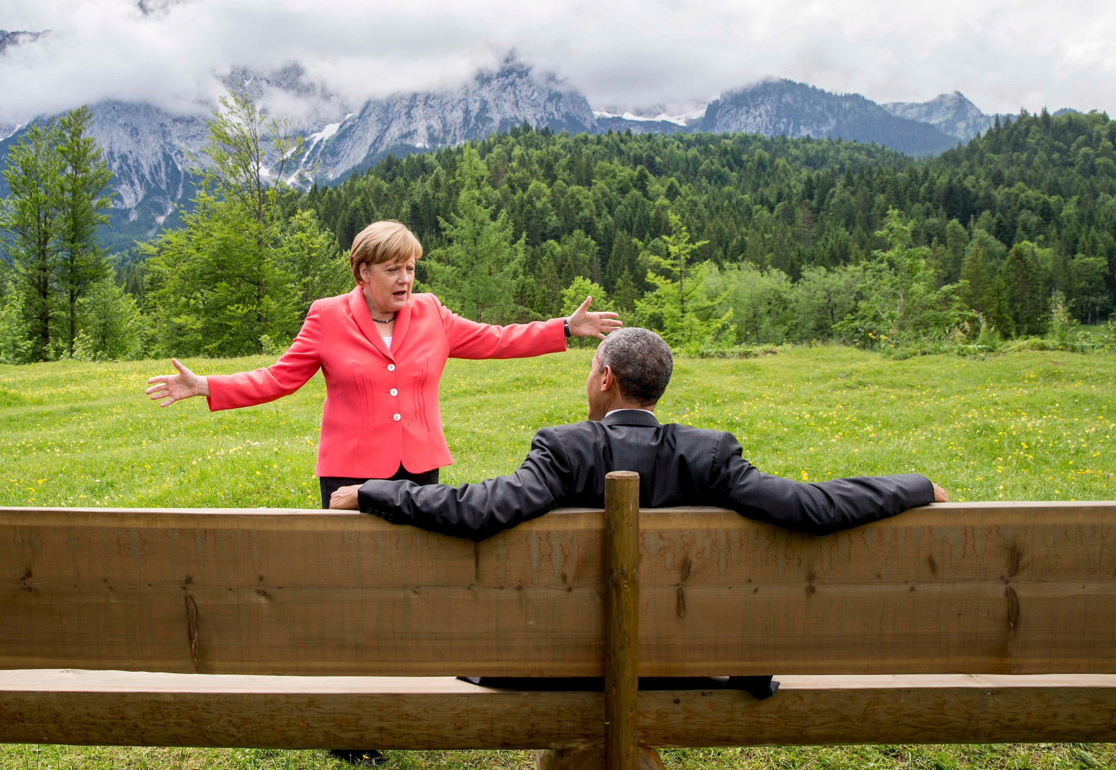 German Chancellor Merkel speaks with U.S. President Obama outside the Elmau castle in Kruen. (Reuters)
