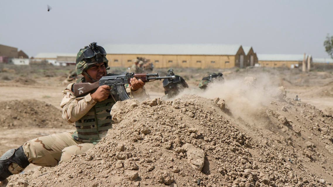 raqi soldiers train with members of the U.S. Army 3rd Brigade Combat Team, 82nd Airborne Division, at Camp Taji, Iraq, in this U.S. Army photo released June 2, 2015.  (Reuters)
