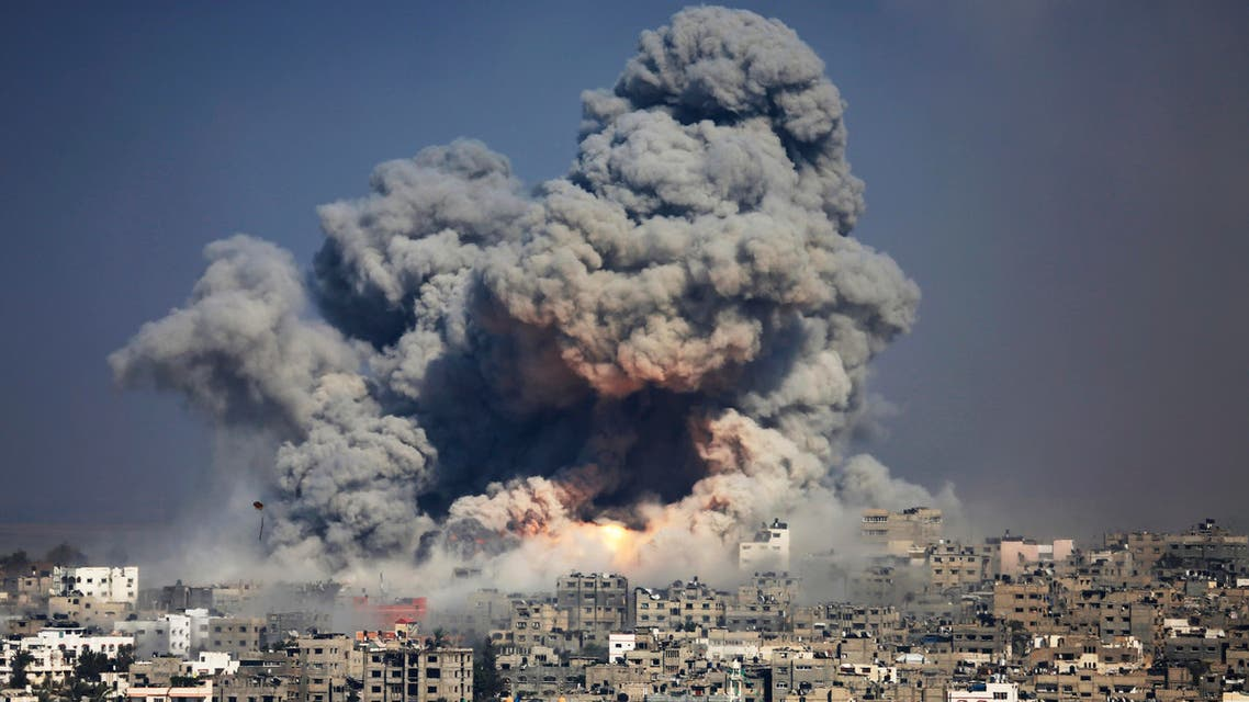In this July 29, 2014 file photo, smoke and fire from an Israeli strike rise over Gaza City. A fierce debate is raging within Israel's military over the extent to which soldiers should be held legally accountable for their actions during last year's Gaza war, with commanders increasingly at odds with military lawyers.(AP)