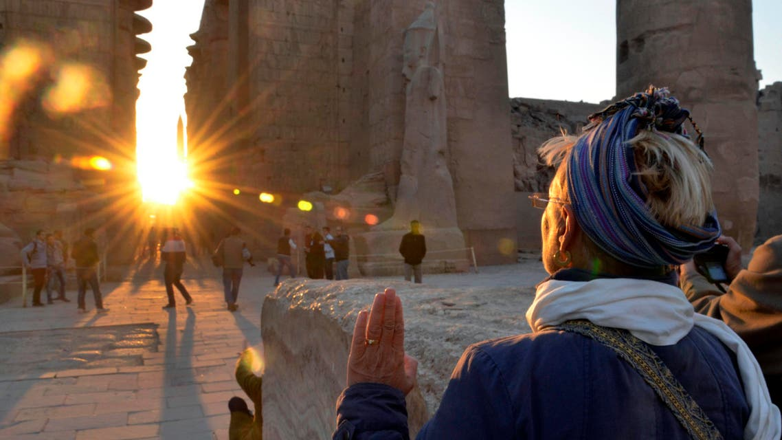 A tourist makes a sunrise visit to the temple of Karnak on the day of the winter solstice in Luxor, 510 kilometers (320 miles) south of Cairo, Egypt, Saturday, Dec. 21, 2013. AP