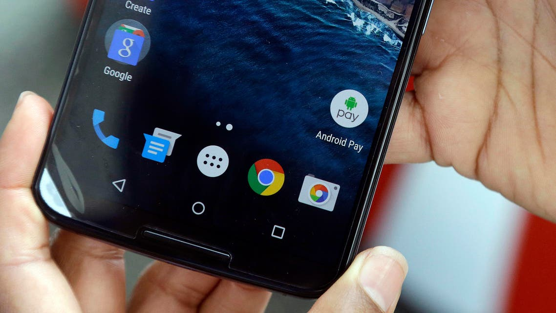 Sherice Torres, director of marketing for Android Pay, shows the icon for the Android Pay app on a phone at Google I/O 2015 in San Francisco, Thursday, May 28, 2015. Google's next version of its Android operating system will boast new ways to fetch information, pay merchants and protect privacy on mobile devices as the Internet company duels with Apple in the quest to make their technology indispensable. (AP Photo/Jeff Chiu)