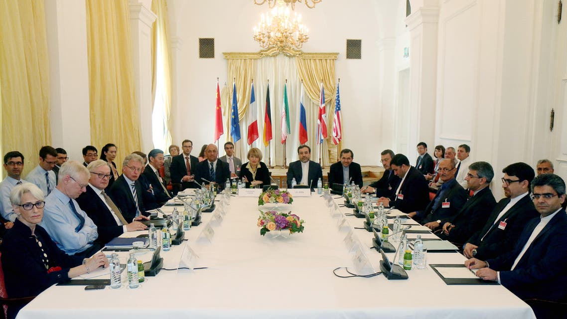 Delegates sit around a table prior to a bilateral meeting as part of the closed-door nuclear talks with Iran at a hotel in Vienna, Austria, Friday, June 12, 2015. While Swiss prosecutors are conducting an espionage investigation amid suspicions that hotels hosting the talks on Iran's nuclear program have been targeted in a cyber-spying campaign, Austria is also looking into the allegations. (AP Photo/Ronald Zak)