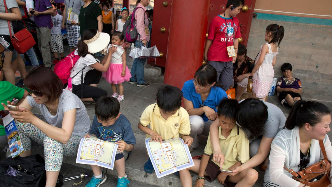 Children look at a map of the Forbidden City during a visit in Beijing. (File Photo: AP)