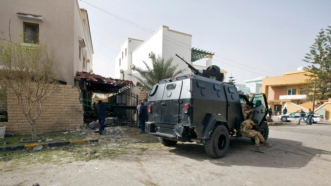 Security Personnel guard the Iranian ambassador's house after it received minor damage caused by an improvised explosive device placed among garbage bags, in Tripoli, Libya, Sunday, Feb. 22, 2015. AP
