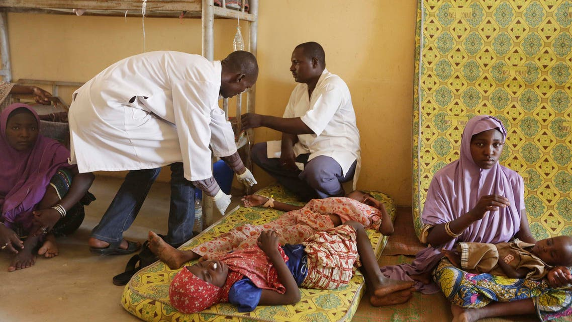 A Sunday, May 3, 2015 photo from files showing doctors as they attend to a sick child rescued by Nigerian soldiers from Boko Haram extremists at a refugee camp in Yola, Nigeria after being rescued from captivity by Boko Haram fighters. AP