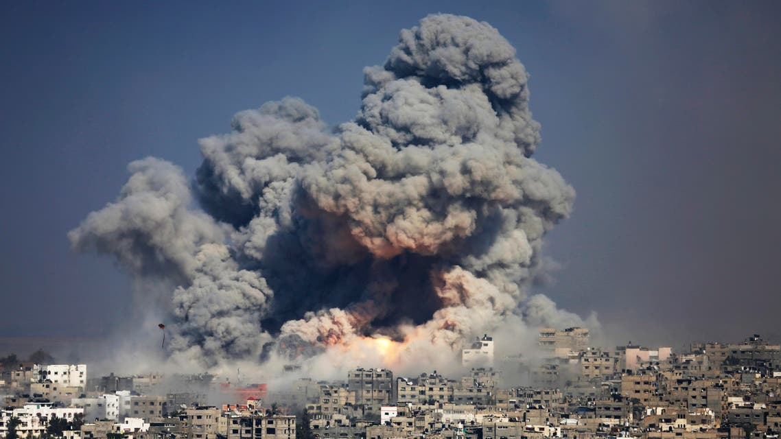 In this July 29, 2014 file photo, smoke and fire from an Israeli strike rise over Gaza City. AP