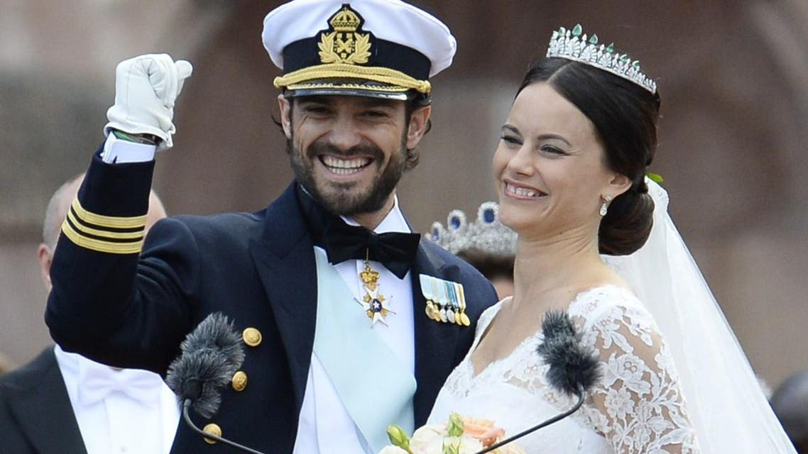 Sweden's Princess Sofia (R) and Sweden's Prince Carl Philip greet the crowds after their wedding ceremony at Stockholm Palace on June 13, 2015. AFP