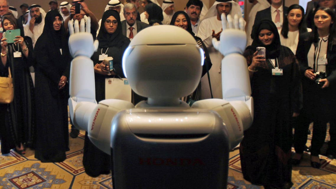 A humanoid robot designed and developed by Honda and named Asimo waves for the audience at the end of the company's presentation during the last day of the Government Summit in Dubai, Feb. 11, 2015. (