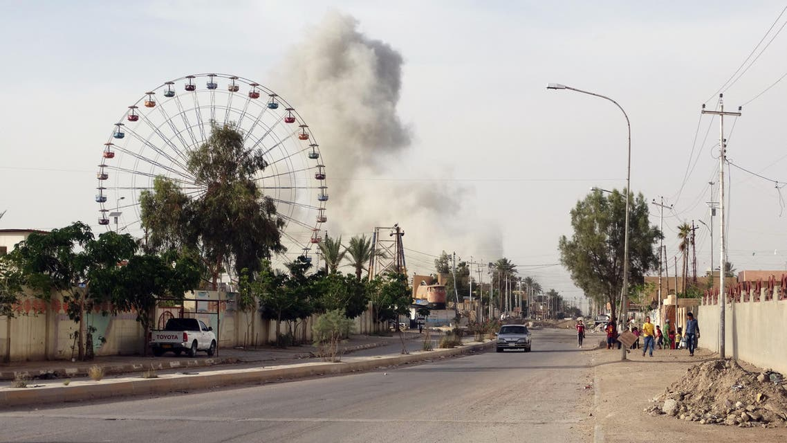 In this Saturday, May 9, 2015 photo, smoke rises after an airstrike by the U.S.-led coalition on Islamic State group positions in an eastern neighborhood of Ramadi, the capital of Anbar province, 115 kilometers west of Baghdad, Iraq. (AP)