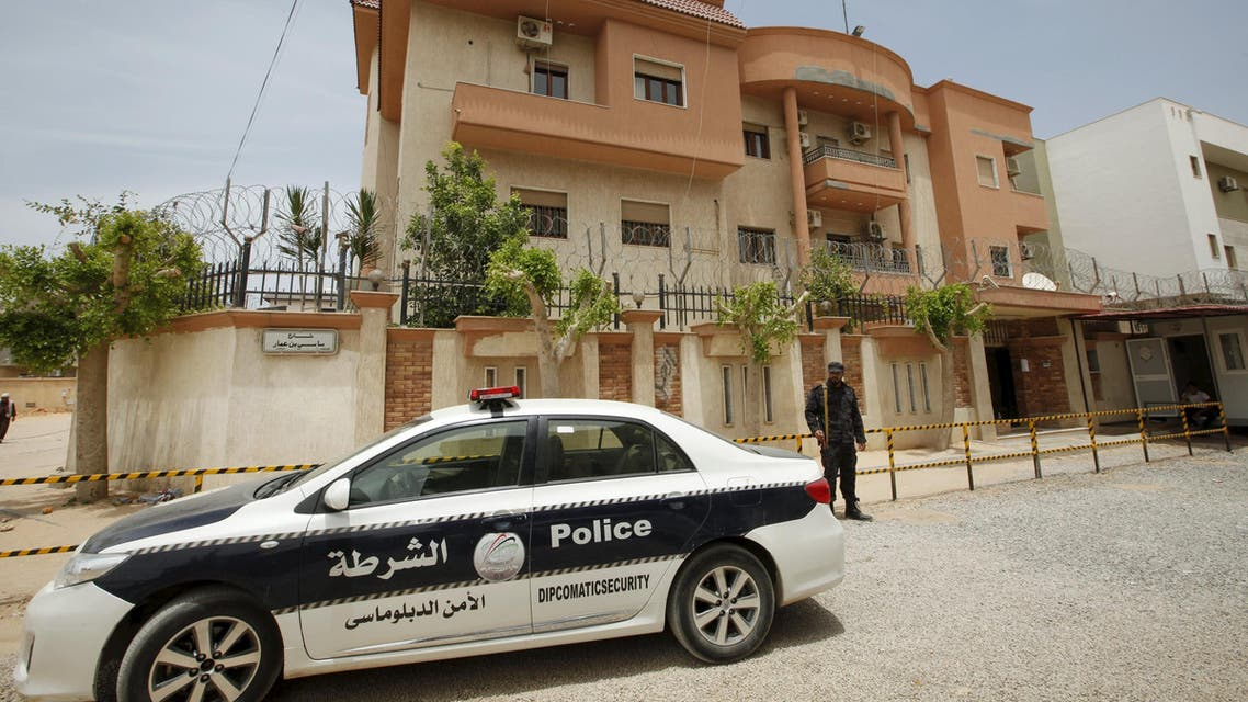 A police vehicle is seen parked in front of the Tunisian consulate in Tripoli, Libya June 13, 2015. (Reuters)