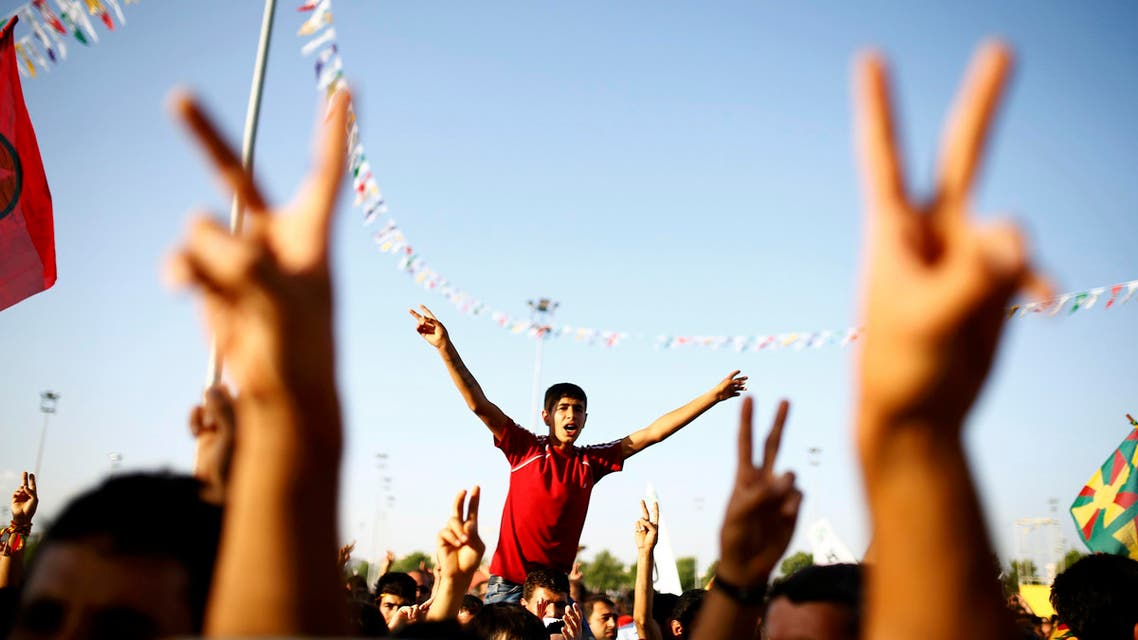 Supporters of the Pro-Kurdish Peoples' Democratic Party (HDP) cheer during a gathering to celebrate their party's victory during the parliamentary election, in Diyarbakir, Turkey, June 8, 2015. REUTERS