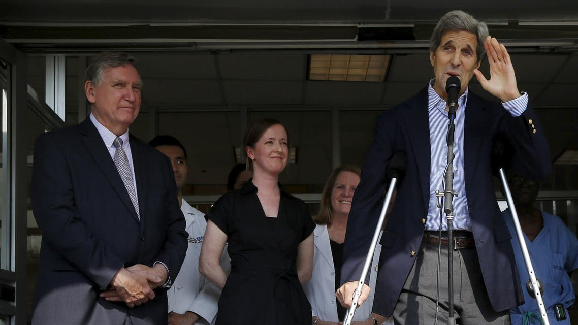 United States Secretary of State John Kerry (R), with Dr. Dennis Burke (L) at his side, waves goodbye after speaking to reporters outside Massachusetts General Hospital in Boston, Massachusetts June 12, 2015. (Reuters)