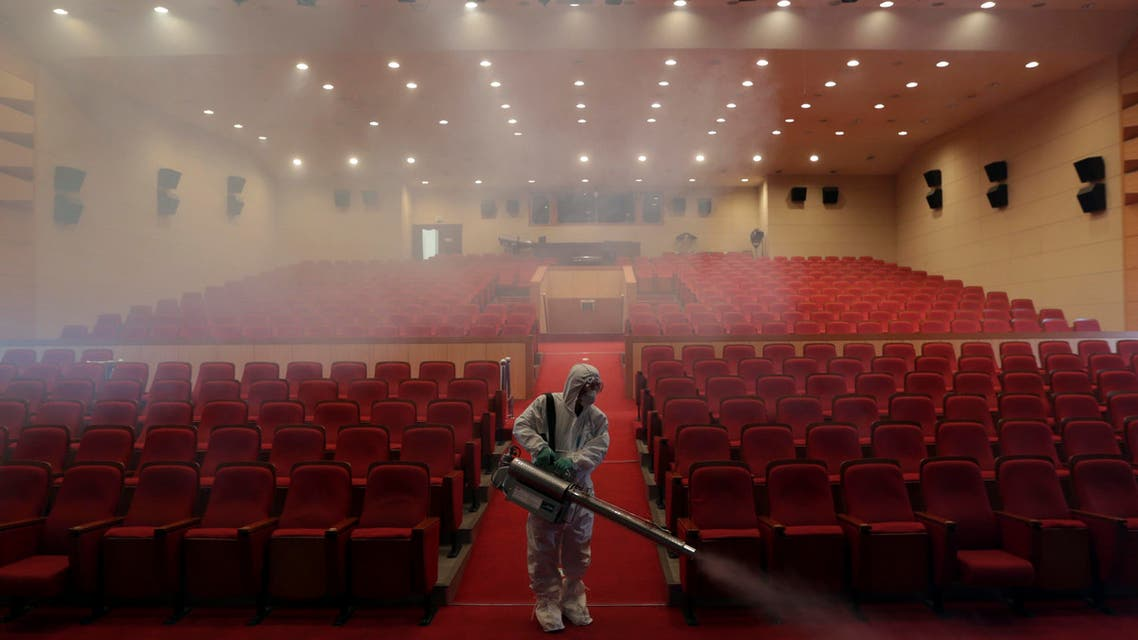 A worker wearing protective gears sprays antiseptic solution as a precaution against the spread of MERS, Middle East Respiratory Syndrome, virus at an art hall in Seoul, South Korea, Friday, June 12, 2015.