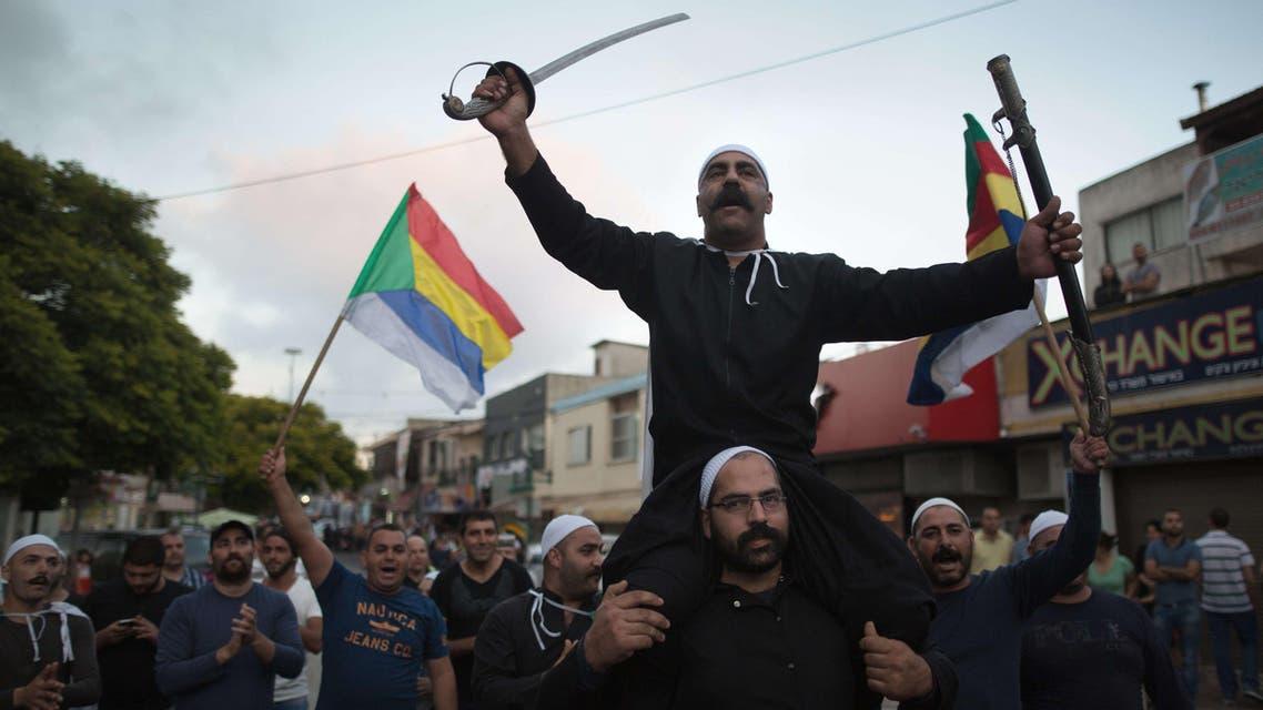 Israelis of the Druze minority take part in a demonstration of some 2000 people in the northern Israeli Druze town of Daliyat al-Carmel on June 14, 2015. (AFP)