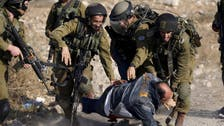 Israel opens probe into Palestinian beating video