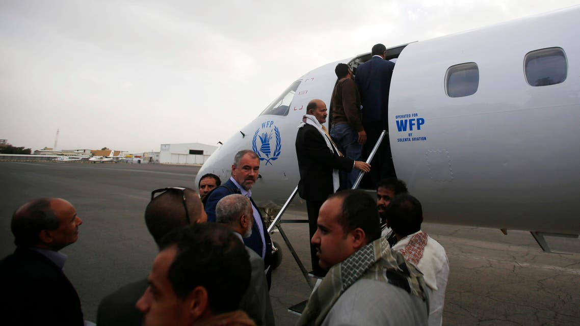 Yemeni political groups, including Shiite rebels known as Houthis, get on an airplane for Geneva for U.N.-led peace talks at the airport in Sanaa, Yemen, Sunday, June 14, 2015. AP