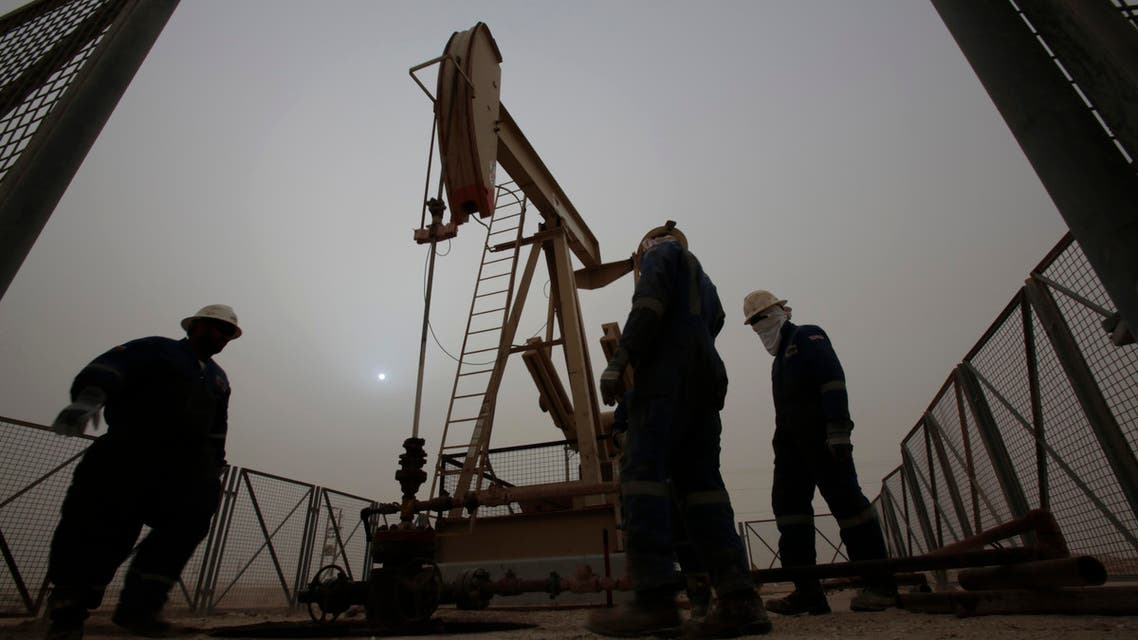 men work on an oil pump during a sandstorm in the desert oil fields of Sakhir, Bahrain. The price of oil dipped below $45 a barrel Tuesday, Jan. 13, 2015, following the latest sign from OPEC that the group doesn't plan to cut production. (AP Photo/Hasan Jamali, File)