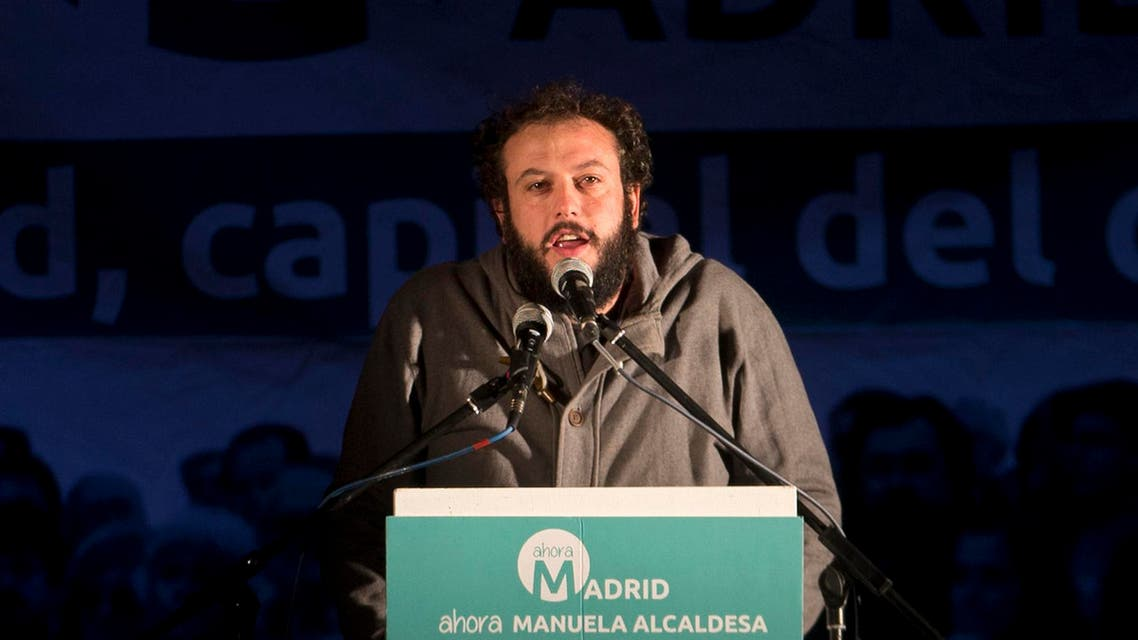 In this photo taken Sunday, May 24, 2015, Madrid's newly appointed leftist culture councilor Guillermo Zapata from the Ahora Mas party gives a speech during an election celebration rally in Madrid, Spain. Zapata resigned Monday June 15, 2015 after coming under heavy criticism for posting a joke on Twitter about the Holocaust four years ago. The Ahora Mas party was sworn in Sunday to lead Madrid's first left-wing city government in 24 years and relies on coalition support from the Socialists to stay in power. (AP Photo/Paul White)
