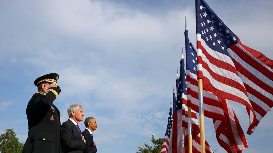 President Barack Obama, Defense Secretary Chuck Hagel, and Joint Chiefs Chairman Gen. Martin Dempsey participate in a ceremony at the Pentagon. (File photo: AP)