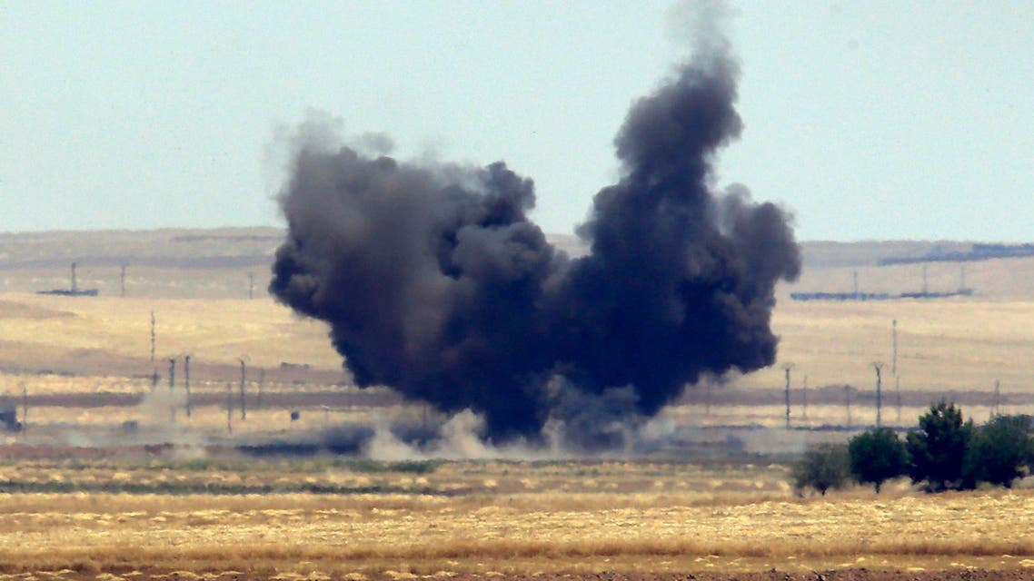 The Turkish side of the border between Turkey and Syria, in Akcakale, Sanliurfa province, southeastern Turkey, smoke from a US-led airstrike rises over the outskirts of Tal Abyad, Syria, Sunday, June 14, 2015. (File Photo: AP)