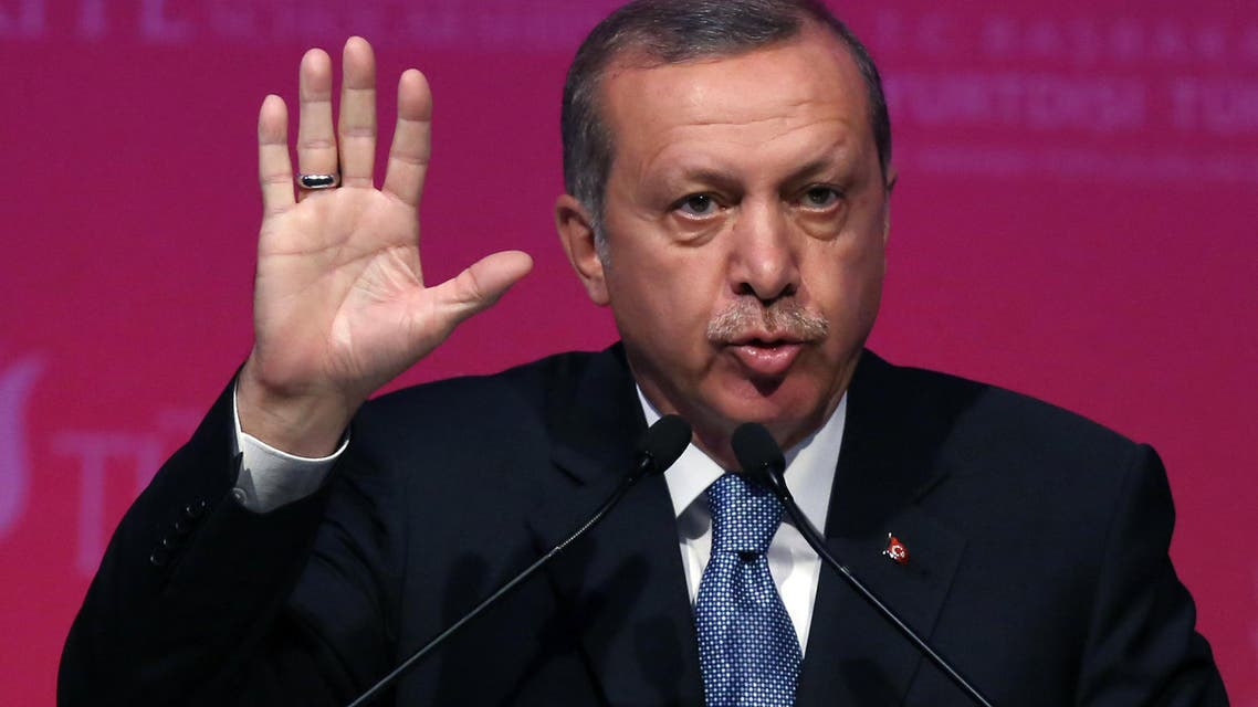 Turkey's President Recep Tayyip Erdogan speaks during a graduation ceremony for foreign students in Ankara, Turkey, Thursday, June 11, 2015. In his first televised appearance since his ruling party lost its parliamentary majority, Erdogan has asked all Turkish political parties to put aside their differences and rapidly form a new government, although Erdogan wanted to change the constitution and form a presidential system of government, his party is now forced to seek a coalition partnership. (AP Photo/Burhan Ozbilici)