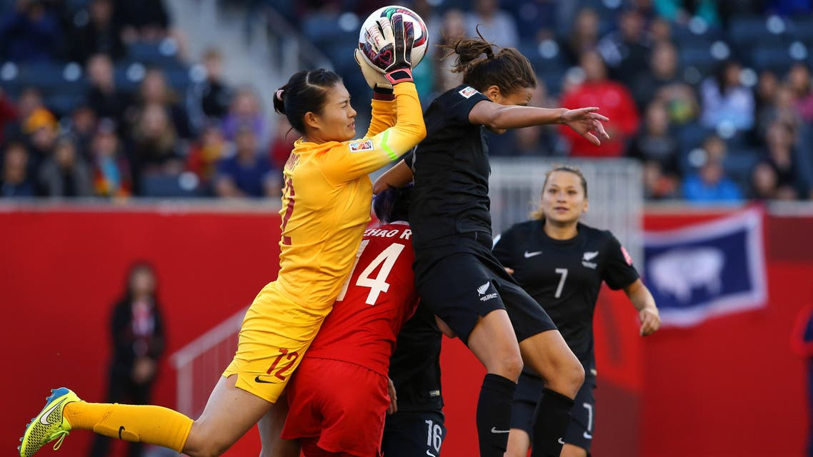 Jun 15, 2015; Winnipeg, Manitoba, CAN; China PR goalkeeper Wang Fei (12) makes a save against New Zealand forward Amber Hearn (right) over China PR forward Zhao Rong (14) in the second half of a Group A soccer match in the 2015 FIFA women's World Cup at Winnipeg Stadium. The game ended in a 2-2 tie. Mandatory Credit: Bruce Fedyck-USA TODAY Sports Open in New Window Download