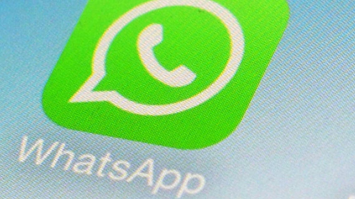 This Feb. 19, 2014 file photo shows WhatsApp and Facebook app icons on a smartphone in New York. One sign of the growing confidence in the US economy was an increase in corporate deals. One of the most high-profile was Facebook's $22 billion acquisition of the mobile-messaging application WhatsApp. (AP Photo/Patrick Sison, File)