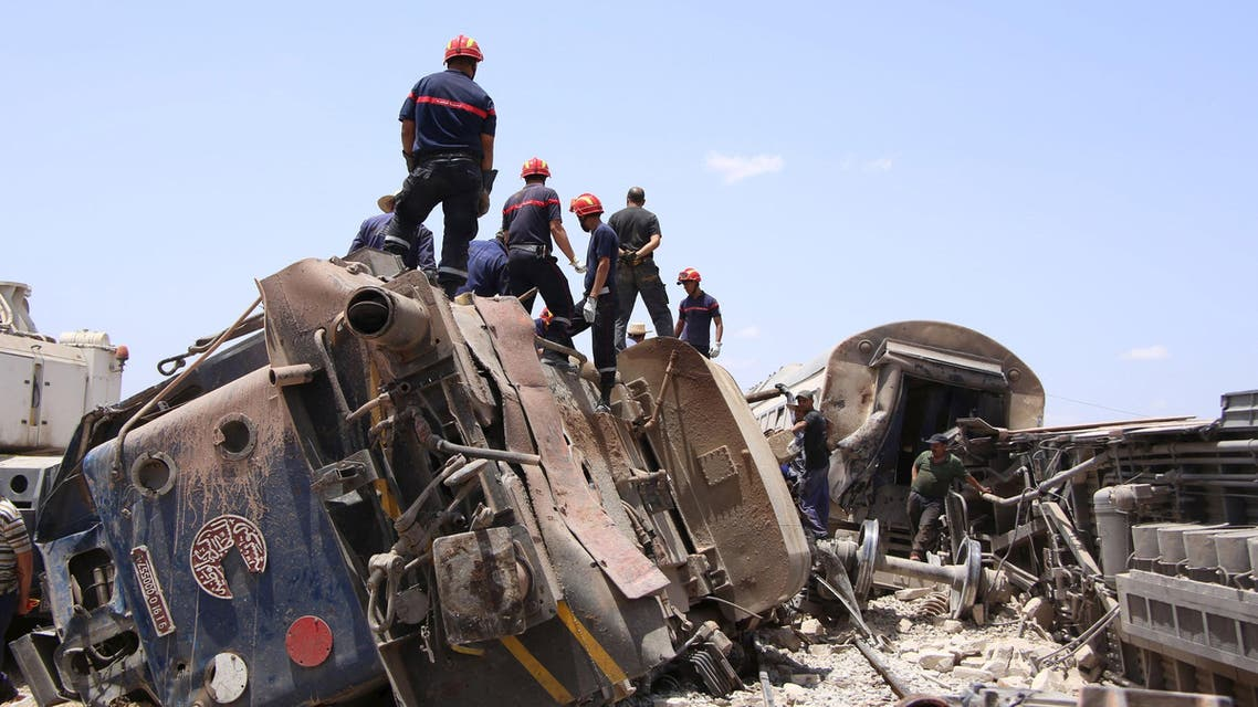 Rescuers work at the site of a collision between a passenger train and a truck in the southern city of Fahs, Tunisia, June 16, 2015. Reuters
